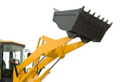 Isolated loader shovel. Risen new loader excavator scoop shovel isolated Stock Images