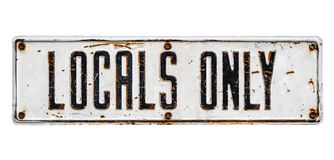 Isolated Locals Only Sign. An Isolated Rusty Locals Only Street Sign From A Small Beach Community On A White Background stock image