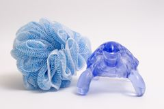 Isolated Loofah. SPA Items isolated blue Loofah royalty free stock photo