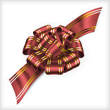 Isolated lush red christmas bow with ribbon over white background Stock Photography