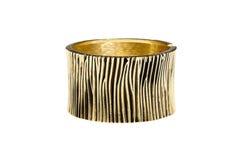 Isolated luxury bracelet. Isolated metallic gold bracelet for woman royalty free stock photo