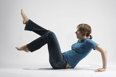 Isolated lying girl. In jeans Stock Image