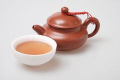 Isolated macro shot tea pot and tea cup Royalty Free Stock Photography