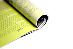 Isolated magazine roll. Isolated magazine roll half read stock images