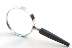 Isolated magnifying glass Stock Photos