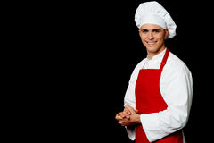 Isolated male chef over black background Royalty Free Stock Photos