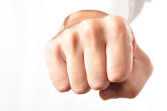 Isolated Male Fist. Male fist, conveying either aggression or success, i.e. fist bump Stock Image