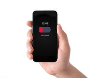 Isolated male hand holding black phone with low charged battery Royalty Free Stock Photos