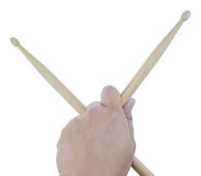 Isolated male left hand holding drum sticks Royalty Free Stock Photo