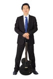 Business man with a black electric guitar Stock Images
