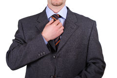 Isolated man fix tie Royalty Free Stock Photography