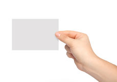 Isolated man hand holding a piece of paper Royalty Free Stock Photo