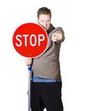 Isolated man holding red traffic stop sign Stock Photos