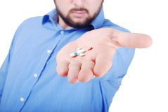 Isolated man offering medical pills Stock Image