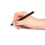 Isolated man's hand holding a black pencil Royalty Free Stock Photos