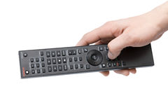 Isolated man's hand with a remote control on white Royalty Free Stock Images