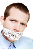 Isolated man with tape measure around mouth Royalty Free Stock Images
