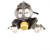 Isolated man wearing gas mask holding blank sign Royalty Free Stock Photography