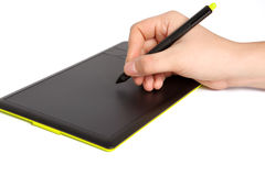 Isolated mans hand draws a pen on a tablet Royalty Free Stock Image