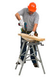 Isolated manual worker using cordless electric dri. Full length portrait isolated worker using cordless electric drill Royalty Free Stock Image