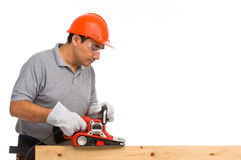 Isolated manual worker using an electric sander Royalty Free Stock Image