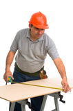 Isolated manual worker using a tape measure Royalty Free Stock Photography