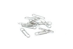 Isolated many metal paper clip on white background Royalty Free Stock Images