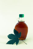 Isolated maple syrup in a bottle.  royalty free stock photos