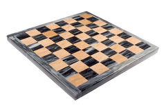 Isolated marble chess board. A marble chess board isolated against a white background Royalty Free Stock Photography