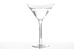 An Isolated Martini Glass. A martini glass with liquid isolated in studio Stock Photography