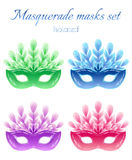 Isolated masquerade masks set on white background. Isolated masquerade masks set: red, green, blue and purple masks with feathers. White background. All elements Royalty Free Stock Photo