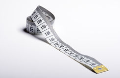 Isolated measure tape. Measure tape over white background colour Royalty Free Stock Photos