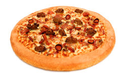Isolated meat lovers pizza. A deep pan pizza isolated on white with clipping path Royalty Free Stock Photography