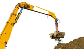 Mechanical digger digging up soil Royalty Free Stock Images
