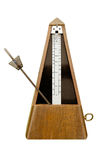 Isolated mechanical metronome. With pendulum bar moving Stock Photography