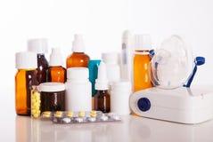 Isolated medicines on white. Isolated medicines with inhaler nebulizer on white Royalty Free Stock Image