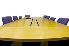 Isolated meeting room with wooden table on white Stock Photography