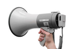 Isolated megaphone in hand on the white. Background Stock Image