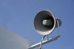 Isolated megaphone making loud noise at day. Isolated megaphone making loud noise at sunny day Royalty Free Stock Photos
