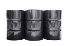 Isolated metal oil barrels. Three metal oil barrel on white with clipping path Stock Image