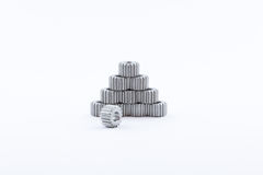 Isolated metal pinions gear. The iron gear on a white background. Pinions in the gearbox. Parts to the gear mechanism. Sprockets t Stock Photos