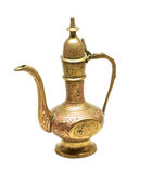 Isolated metallic kettle. Old golden metallic kettle with ethnic ornaments royalty free stock images