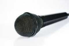 Isolated microphone. Black microphone isolated over white Royalty Free Stock Image