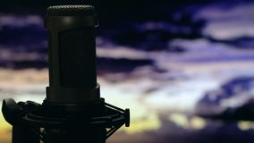 Isolated microphone on stand background cloudy sky Royalty Free Stock Image
