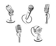 Isolated microphones Stock Photo
