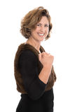 Isolated middle aged woman making fist - happy about her success Stock Photo