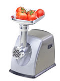 Isolated mincer  with tomatoes Stock Photos