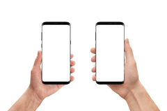 Isolated mobile phones in woman and man hand. Isolated white, blank screen for mockup, app presentation. White background Royalty Free Stock Photo