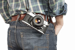 Isolated modern man with film camera Royalty Free Stock Photos