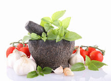 Isolated mortar and ingredient Royalty Free Stock Image